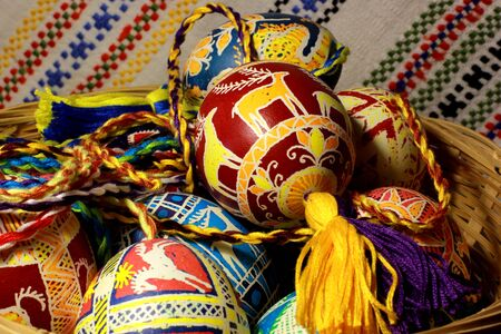 Handmade colored Easter eggs on traditional Ukrainian cloth background Stock Photo