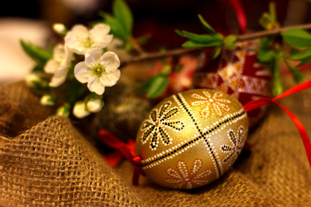 Easter decorated eggs on the cloth background. Spring of flowering tree.