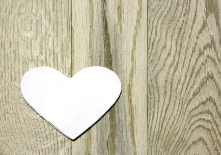 White heart  on  wooden background. Love card for Valentine's day. Concept with big copyspase for hand crafts or DIY illustration.