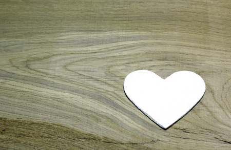 White heart on wooden background. Love card for Valentines day. Concept with big copyspase for hand crafts or DIY illustration. Stock Photo