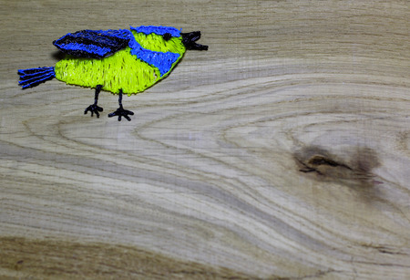 Blue tit on wooden background. Spring bird. Child`s hand made draw with 3D printing pen. Love card for Valentines day. Concept with big copyspase for hand crafts or DIY illustration. Stock Photo