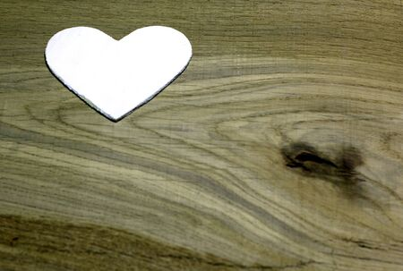 White heart  on  wooden background. Love card for Valentines day. Concept with big copyspase for hand crafts or DIY illustration.
