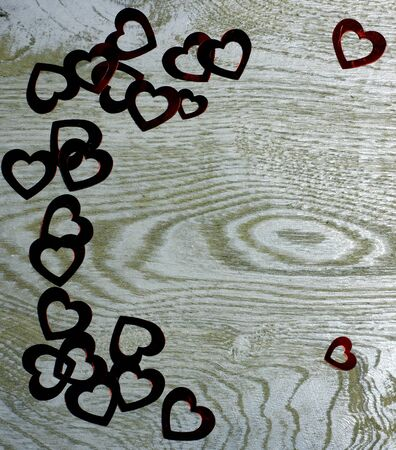 Corner frame border of Hearts on wooden background. Love card for Valentine's day. Concept with big copyspase for hand made crafts or DIY illustration.