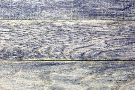 Old dark wooden background.
