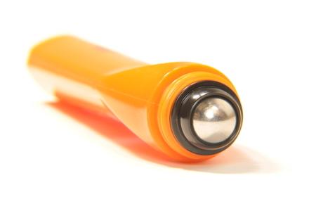 applicator: Orange plastic  roll-on cosmetic applicator with steel ball
