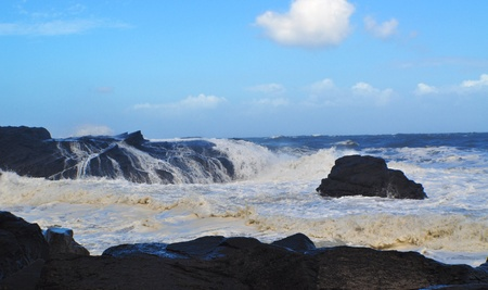 Blue sky with surf breaking on rocks. Toucheng Township, Yilan