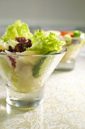 Fresh salad in glass bowl Stock Photo