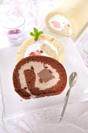 Romantic dessert time with vanilla and chocolate swiss roll