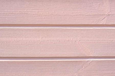background of wooden boards painted with light pink paint