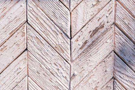 .old peeling paint on wooden boards, craquelure, beige
