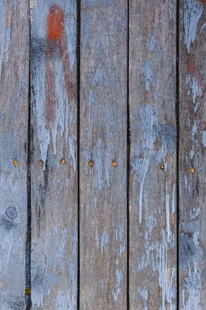 old, peeling paint on wooden boards, craquelure