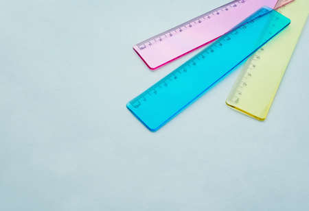 multicolored school rulers on a light background