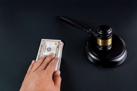 judge and money on the black background
