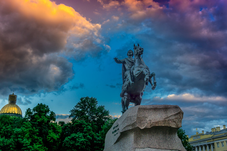 Saint Petersburg, Russia. Bronze horseman monument at sunset with dramatic clouds and light