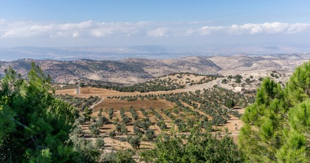 Stunning panoramic view of the Jordan Valley with view of olive groves on a cloudy day.