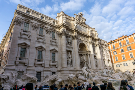 February 2018: building and sky view of Trevi fountain in Rome, italy