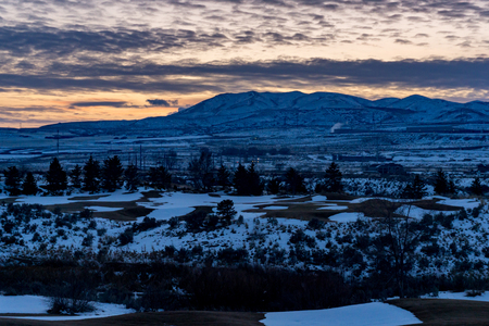 Last light at dusk above the Rocky Mountains in Utah during winter