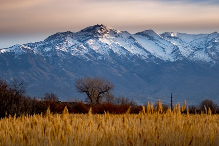 Sunset over the snow-capped Rocky Mountains inthe background of this beautiful landscape Stok Fotoğraf