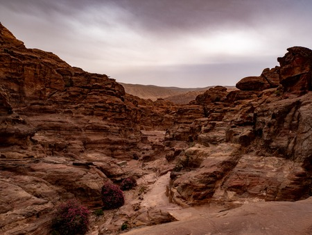 Stormy sky over the lonely and deserted desert landscape in the mountains