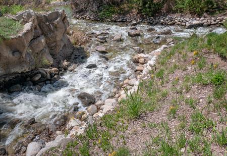 Small creek flows and splashes along a mountain stream in Utah, USA Stok Fotoğraf
