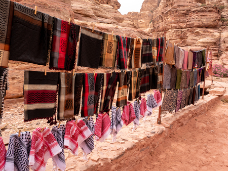 Colorful scarves for sale along a desert trail in the desert inthe Middle East