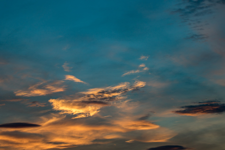 Beautiful and colorful background of a sunset sky during the golden hour Stok Fotoğraf