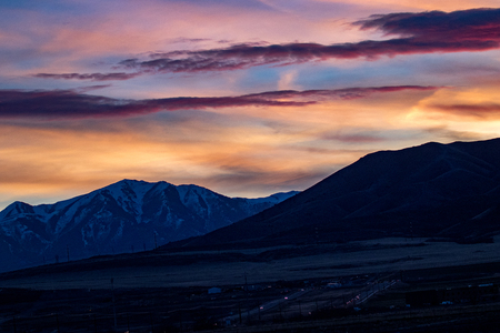 The snow-capped Rocky Mountains at sunset or sunrise with a beautifully colorful sky Stok Fotoğraf