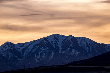 Snowy ridgeline in the Rocky Mountains at sunset or sunrise