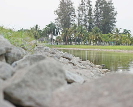 river side: Rocks by the river side. Stock Photo