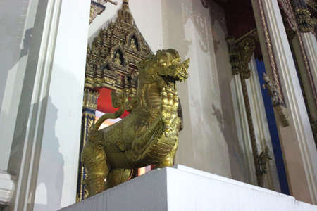 Lion statue stand majestic in temple.