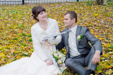 the happy newly-married couple playing in the gold autumn  Stock Photo - 11510358