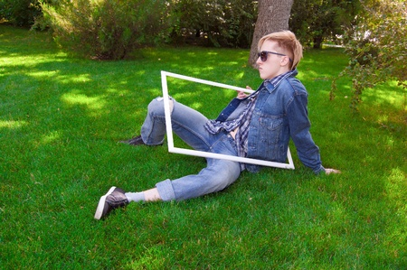pensiveness: blue frame goggles grass green has human jacket jean the white y Stock Photo