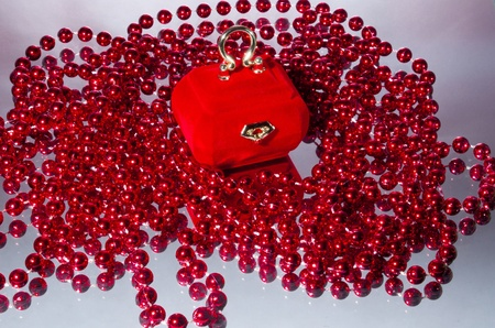 velvety: velvety casket for jewels with red beads