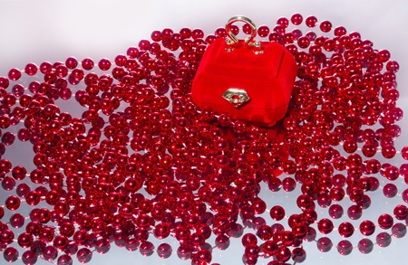 velvety casket for jewels with red beads photo
