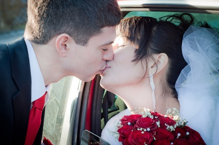 newly-married couple kissing photo