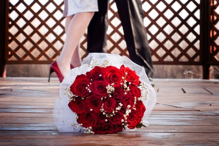 couple were twirling around the dance floor with wedding red bouquet  Stock Photo - 11902245