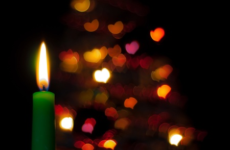booked: green candle on the black background with hearts