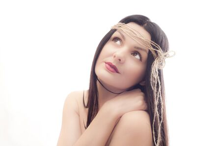 Portrait of the beautiful young girl with an old rope on a head on a white background Stock Photo - 12683693