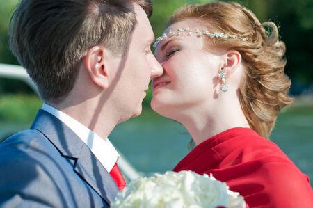 happy and beautiful newlyweds kissclose up photo