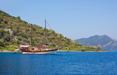 the small ship costs at coast of one of islands of the Aegean Sea, Marmaris, Turkey