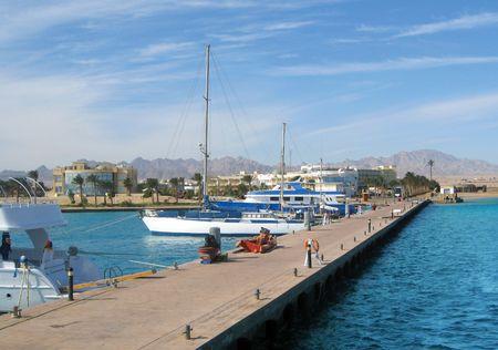 moorings: Sea Yachts near shore under bright sunlight