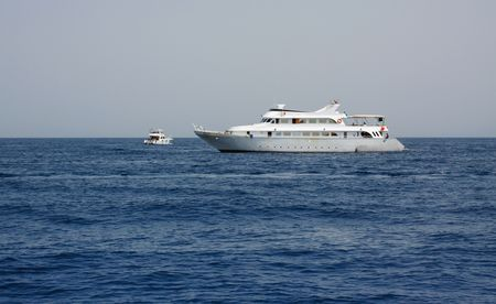 the seas: High Seas. Two Sea Yachts at midday Stock Photo
