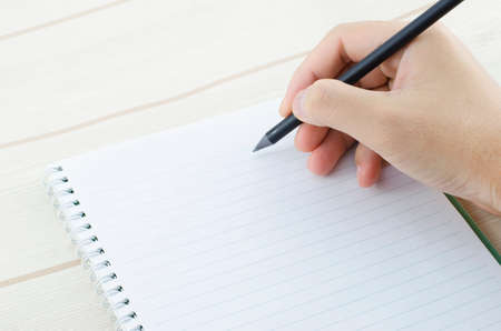hand pen: hand writing on notebook