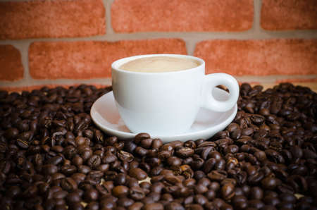 Cup of coffee and coffee beans photo