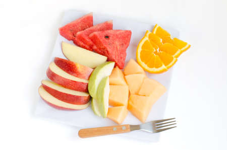 Fresh fruits in plate Apple MelonWatermelonOrange and guava with clipping path photo