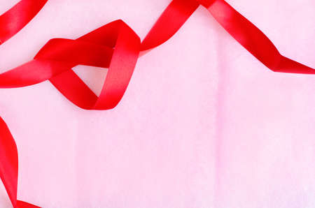 rosy: Rosy pink paper texture background with red ribbon