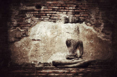 civilization: Old broken Buddha statue on grunge brick wall background with vintage and vignette tone - Civilization collapse Stock Photo
