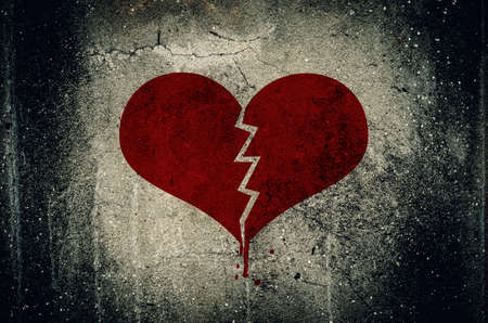 sad heart: Heart broken painted on grunge cement wall background - love concept