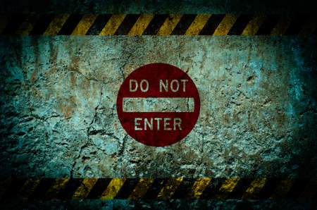 do not enter warning sign: Do not enter warning sign on dirty wall background with grunge and vignette tone