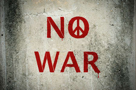 peace sign: Red No War message and peace symbol graffiti on grunge ciment wall - peace concept Stock Photo